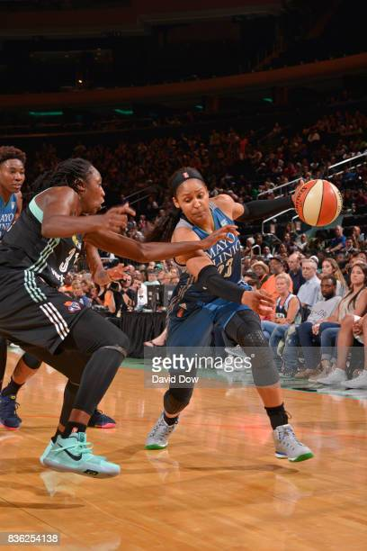 Maya Moore of the Minnesota Lynx handles the ball against Tina Charles of the New York Liberty during the WNBA game on August 20 2017 at the Madison...