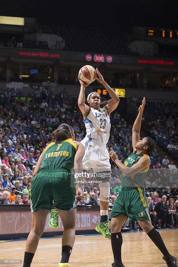 Maya Moore #23 of the Minnesota Lynx looks to pass against Tanisha Wright #30 and Tina Thompson #7 of the Seattle Storm during the WNBA Western Conference Semifinals Game 1 on September 20, 2013 at Target Center in Minneapolis, Minnesota.
