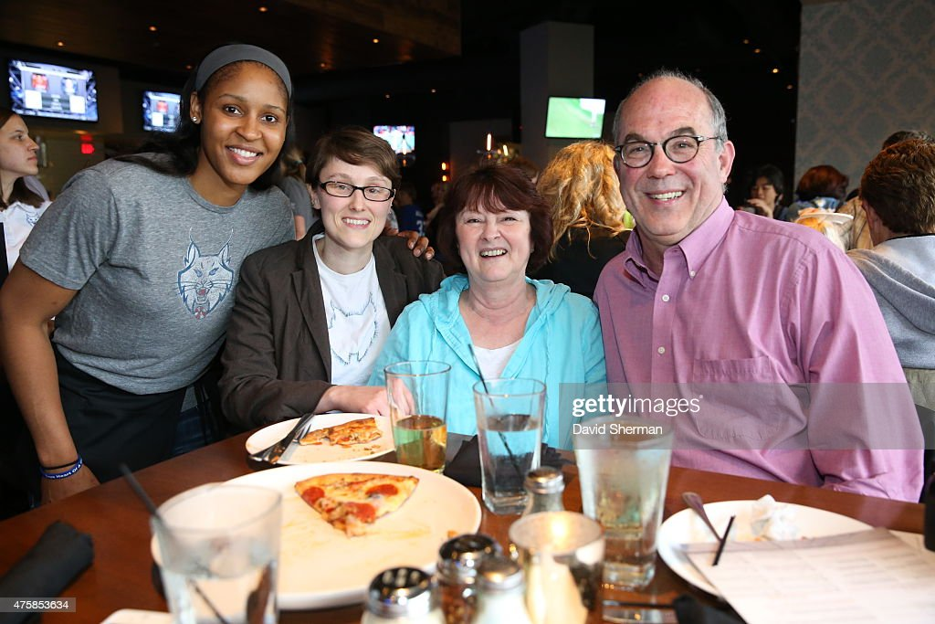 <a gi-track='captionPersonalityLinkClicked' href=/galleries/search?phrase=Maya+Moore&family=editorial&specificpeople=4215914 ng-click='$event.stopPropagation()'>Maya Moore</a> #23 of the Minnesota Lynx poses with fans during the Tip-A-Lynx fundraiser to benefit the Minnesota Lynx Fastbreak Foundation on June 3, 2015 at the Loop West End Bar & Restaurant in Minneapolis, Minnesota.