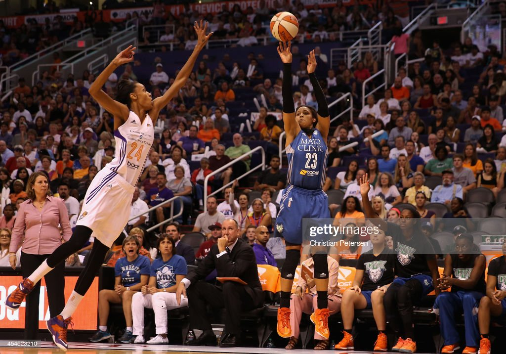<a gi-track='captionPersonalityLinkClicked' href=/galleries/search?phrase=Maya+Moore&family=editorial&specificpeople=4215914 ng-click='$event.stopPropagation()'>Maya Moore</a> #23 of the Minnesota Lynx puts up a three point shot past <a gi-track='captionPersonalityLinkClicked' href=/galleries/search?phrase=DeWanna+Bonner&family=editorial&specificpeople=4085058 ng-click='$event.stopPropagation()'>DeWanna Bonner</a> #24 of the Phoenix Mercury during the first half of game three of the WNBA Western Conference Finals at US Airways Center on September 2, 2014 in Phoenix, Arizona.