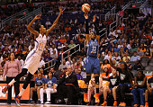 Maya Moore of the Minnesota Lynx puts up a three point shot past DeWanna Bonner of the Phoenix Mercury during the first half of game three of the...