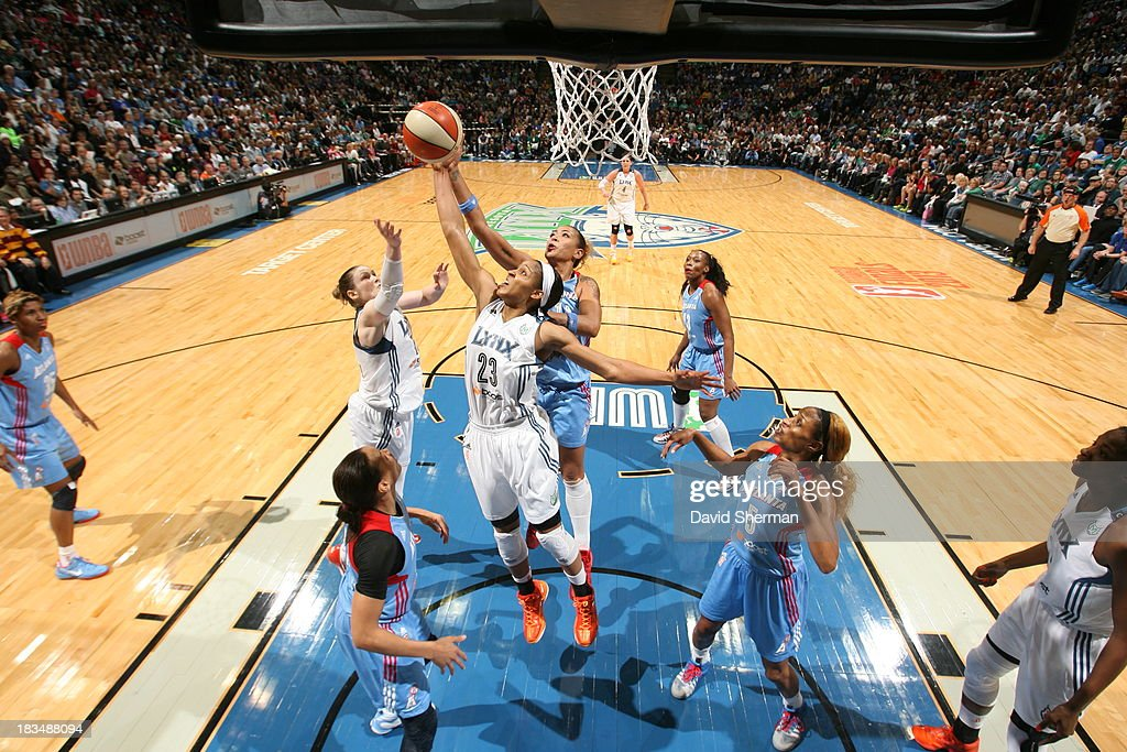 <a gi-track='captionPersonalityLinkClicked' href=/galleries/search?phrase=Maya+Moore+-+Basketball+Player&family=editorial&specificpeople=4215914 ng-click='$event.stopPropagation()'>Maya Moore</a> #23 of the Minnesota Lynx reaches for a rebound against Erika de Souza #14 of the Atlanta Dream during Game 1 of the 2013 WNBA Finals on October 6, 2013 at Target Center in Minneapolis, Minnesota.