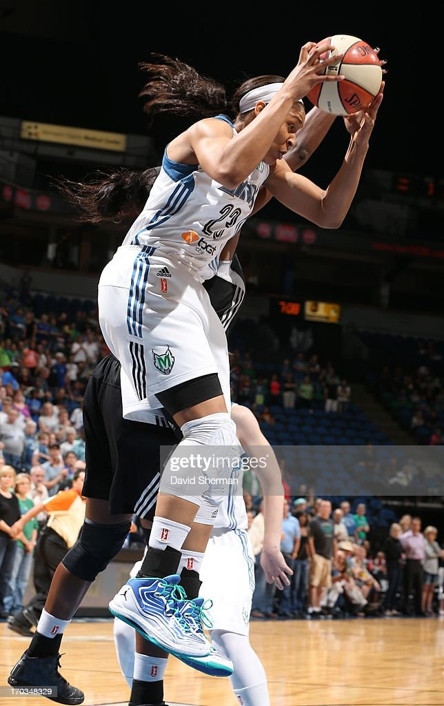Maya Moore #23 of the Minnesota Lynx rebounds the ball against Jia Perkins #7 of the San Antonio Silver Stars during the WNBA game on June 11, 2013 at Target Center in Minneapolis, Minnesota.