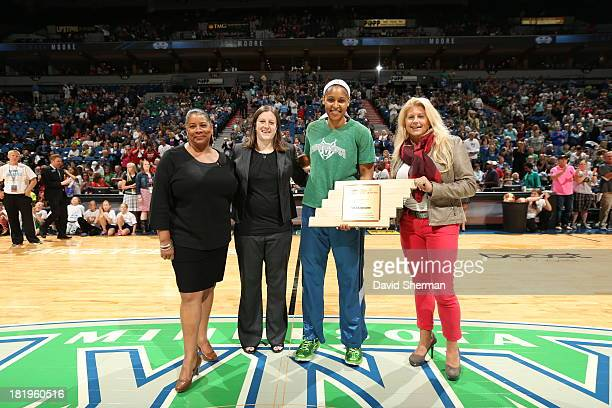 Maya Moore of the Minnesota Lynx receives the Cares Community Assist Award presented by WNBA President Laurel J Richie Lynx Director of Business...