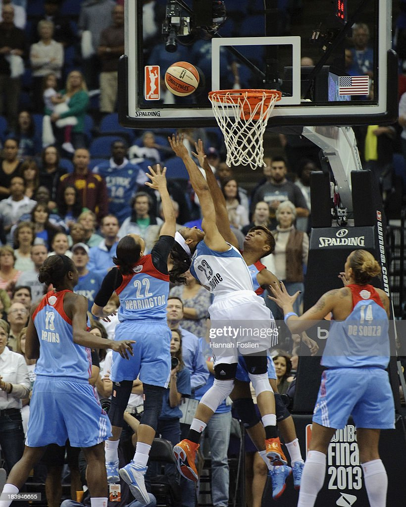<a gi-track='captionPersonalityLinkClicked' href=/galleries/search?phrase=Maya+Moore&family=editorial&specificpeople=4215914 ng-click='$event.stopPropagation()'>Maya Moore</a> #23 of the Minnesota Lynx shoots a basket against <a gi-track='captionPersonalityLinkClicked' href=/galleries/search?phrase=Angel+McCoughtry&family=editorial&specificpeople=4423621 ng-click='$event.stopPropagation()'>Angel McCoughtry</a> #35 of the Atlanta Dream during Game Two of the 2013 WNBA Finals on October 8, 2013 at Target Center in Minneapolis, Minnesota.