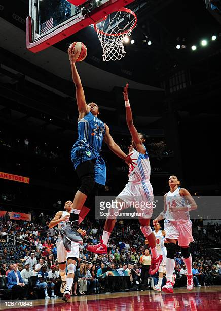 Maya Moore of the Minnesota Lynx shoots against Angel McCoughtry of the Atlanta Dream during Game Three of the 2011 WNBA Finals at Philips Arena on...