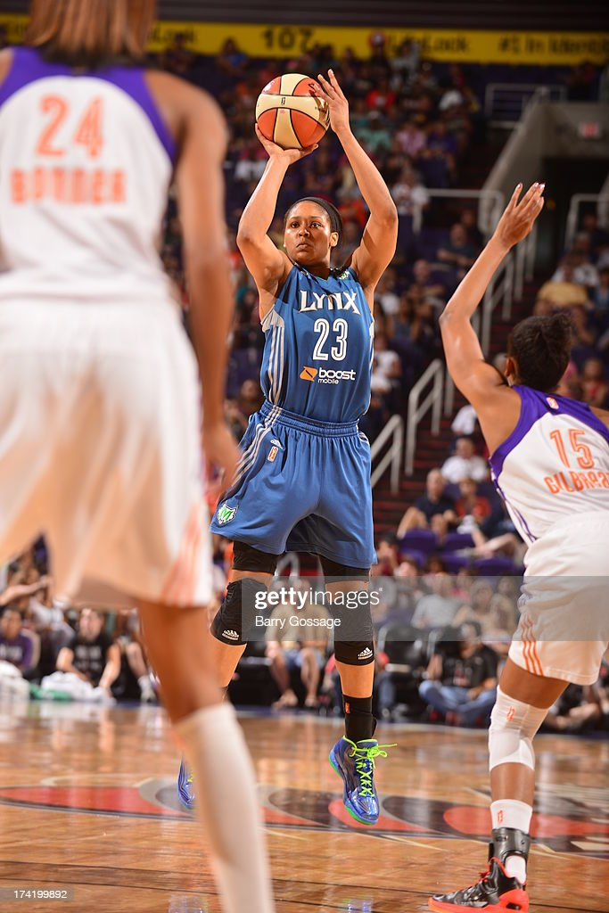 <a gi-track='captionPersonalityLinkClicked' href=/galleries/search?phrase=Maya+Moore+-+Basketball+Player&family=editorial&specificpeople=4215914 ng-click='$event.stopPropagation()'>Maya Moore</a> #23 of the Minnesota Lynx shoots against Briana Gilbreath #15 of the Phoenix Mercury on July 21, 2013 at U.S. Airways Center in Phoenix, Arizona.