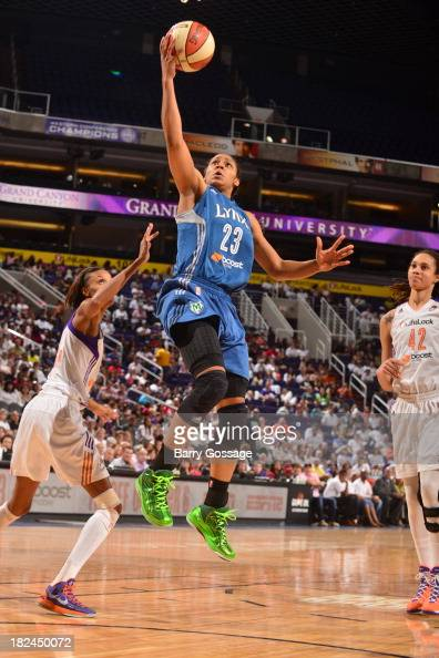 Maya Moore of the Minnesota Lynx shoots against DeWanna Bonner of the Phoenix Mercury in Game 2 of the Western Conference Finals during 2013 WNBA...