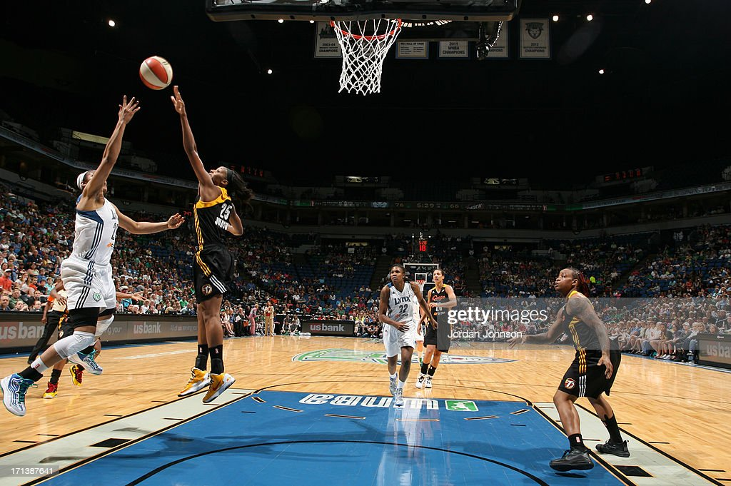 <a gi-track='captionPersonalityLinkClicked' href=/galleries/search?phrase=Maya+Moore&family=editorial&specificpeople=4215914 ng-click='$event.stopPropagation()'>Maya Moore</a> #23 of the Minnesota Lynx shoots against Glory Johnson #25 of the the Tulsa Shock during the WNBA game on June 23, 2013 at Target Center in Minneapolis, Minnesota.