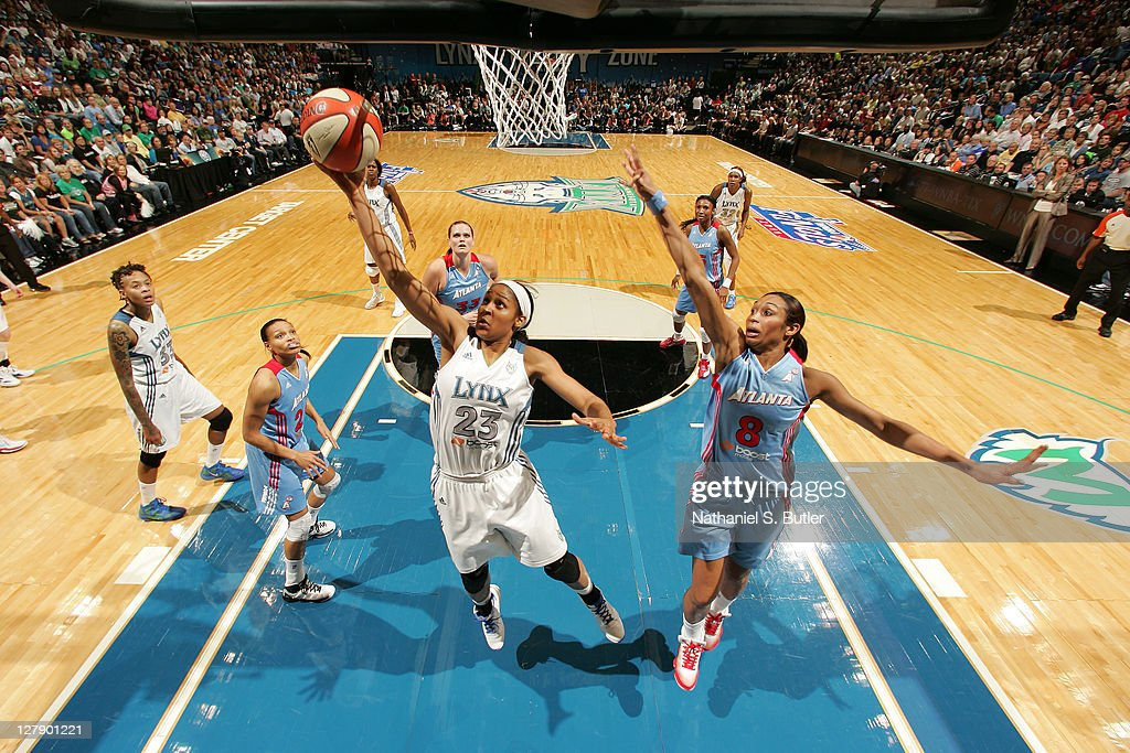 <a gi-track='captionPersonalityLinkClicked' href=/galleries/search?phrase=Maya+Moore&family=editorial&specificpeople=4215914 ng-click='$event.stopPropagation()'>Maya Moore</a> #23 of the Minnesota Lynx shoots against <a gi-track='captionPersonalityLinkClicked' href=/galleries/search?phrase=Iziane+Castro+Marques&family=editorial&specificpeople=550261 ng-click='$event.stopPropagation()'>Iziane Castro Marques</a> #8 of the Atlanta Dream in Game One of the 2011 WNBA Finals on October 2, 2011 at Target Center in Minneapolis, Minnesota.