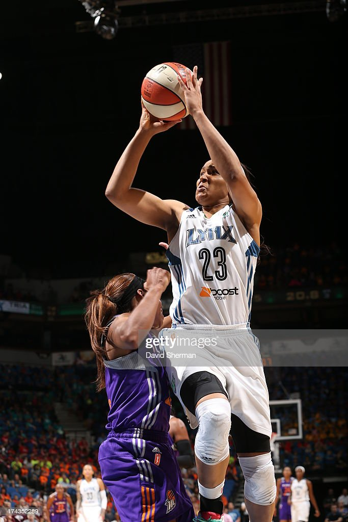 <a gi-track='captionPersonalityLinkClicked' href=/galleries/search?phrase=Maya+Moore&family=editorial&specificpeople=4215914 ng-click='$event.stopPropagation()'>Maya Moore</a> #23 of the Minnesota Lynx shoots against Jasmine James #10 of the the Phoenix Mercury during the WNBA game on July 24, 2013 at Target Center in Minneapolis, Minnesota.