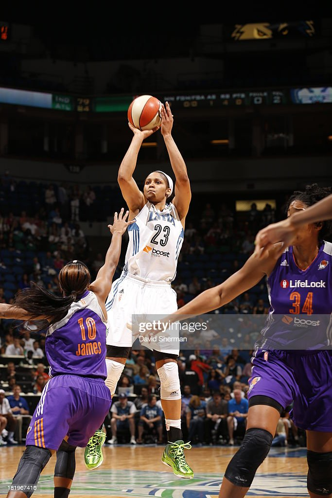 <a gi-track='captionPersonalityLinkClicked' href=/galleries/search?phrase=Maya+Moore&family=editorial&specificpeople=4215914 ng-click='$event.stopPropagation()'>Maya Moore</a> #23 of the Minnesota Lynx shoots against Jasmine James #10 of the Phoenix Mercury during the WNBA Western Conference Finals Game 1 on September 26, 2013 at Target Center in Minneapolis, Minnesota.