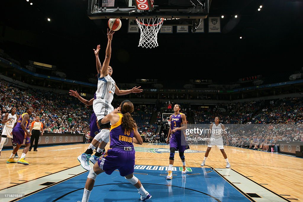 <a gi-track='captionPersonalityLinkClicked' href=/galleries/search?phrase=Maya+Moore+-+Basketball+Player&family=editorial&specificpeople=4215914 ng-click='$event.stopPropagation()'>Maya Moore</a> #23 of the Minnesota Lynx shoots against <a gi-track='captionPersonalityLinkClicked' href=/galleries/search?phrase=Lindsey+Harding&family=editorial&specificpeople=704302 ng-click='$event.stopPropagation()'>Lindsey Harding</a> #10 of the the Los Angeles Sparks during the WNBA game on June 28, 2013 at Target Center in Minneapolis, Minnesota.