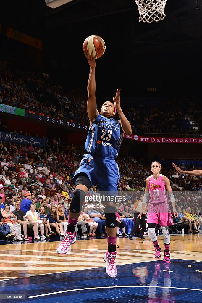 <a gi-track='captionPersonalityLinkClicked' href=/galleries/search?phrase=Maya+Moore&family=editorial&specificpeople=4215914 ng-click='$event.stopPropagation()'>Maya Moore</a> #23 of the Minnesota Lynx shoots against the Connecticut Sun on July 27, 2014 at the Mohegan Sun Arena in Uncasville, Connecticut.