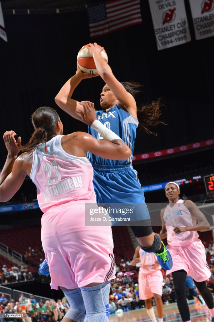 <a gi-track='captionPersonalityLinkClicked' href=/galleries/search?phrase=Maya+Moore&family=editorial&specificpeople=4215914 ng-click='$event.stopPropagation()'>Maya Moore</a> #23 of the Minnesota Lynx shoots against the New York Liberty during the game on August 27, 2013 at Prudential Center in Newark, New Jersey.