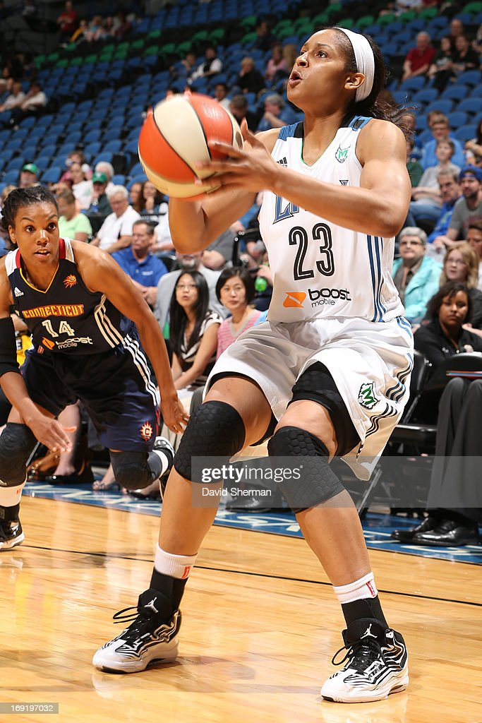 <a gi-track='captionPersonalityLinkClicked' href=/galleries/search?phrase=Maya+Moore&family=editorial&specificpeople=4215914 ng-click='$event.stopPropagation()'>Maya Moore</a> #23 of the Minnesota Lynx shoots during the WNBA pre-season game against the Connecticut Sun on May 21, 2013 at Target Center in Minneapolis, Minnesota.