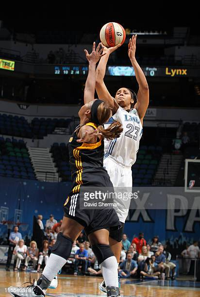 Maya Moore of the Minnesota Lynx shoots over Amber Holt of the Tulsa Shock during the game on June 7 2011 at the Target Center in Minneapolis...