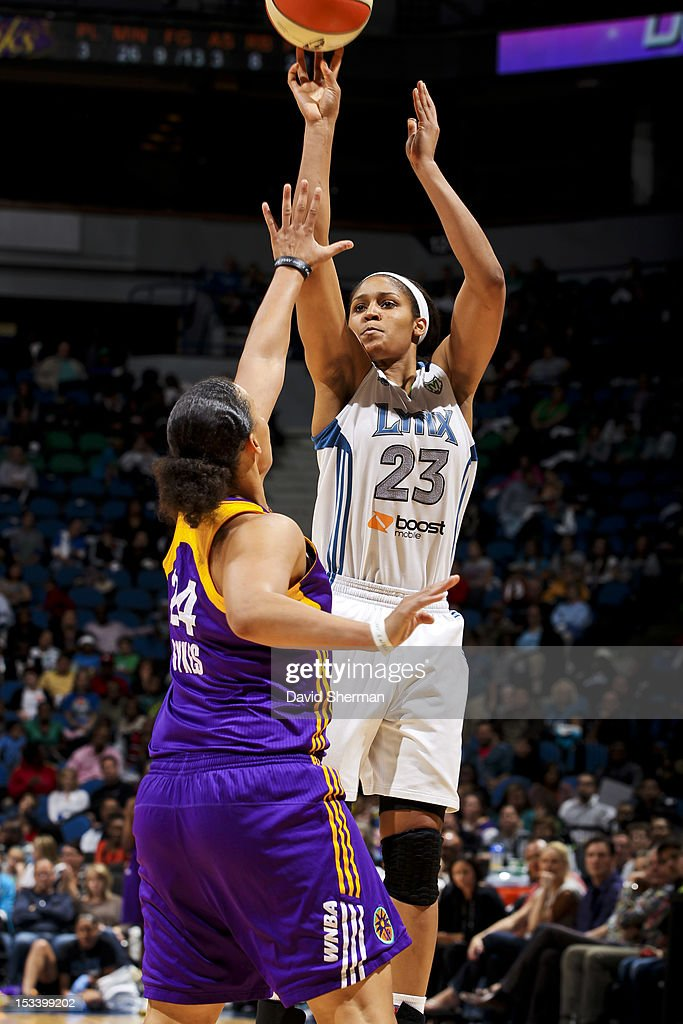 Maya Moore #23 of the Minnesota Lynx shoots the ball against April Sykes #24 of the Los Angeles Sparks during Game One of the 2012 WNBA Western Conference Finals on October 4, 2012 at Target Center in Minneapolis, Minnesota.