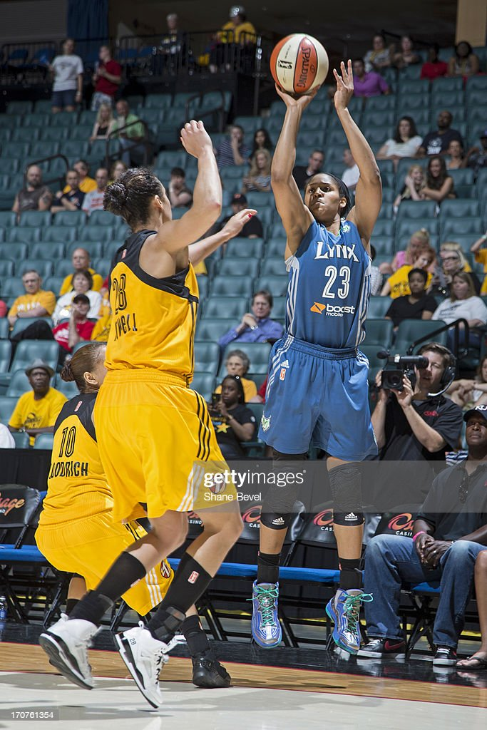 <a gi-track='captionPersonalityLinkClicked' href=/galleries/search?phrase=Maya+Moore&family=editorial&specificpeople=4215914 ng-click='$event.stopPropagation()'>Maya Moore</a> #23 of the Minnesota Lynx shoots the ball against the Tulsa Shock during the WNBA game on June 14, 2013 at the BOK Center in Tulsa, Oklahoma.