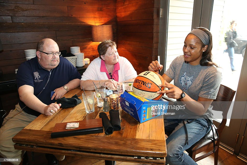 <a gi-track='captionPersonalityLinkClicked' href=/galleries/search?phrase=Maya+Moore&family=editorial&specificpeople=4215914 ng-click='$event.stopPropagation()'>Maya Moore</a> #23 of the Minnesota Lynx signs autographs during the Tip-A-Lynx fundraiser to benefit the Minnesota Lynx Fastbreak Foundation on June 3, 2015 at the Loop West End Bar & Restaurant in Minneapolis, Minnesota.
