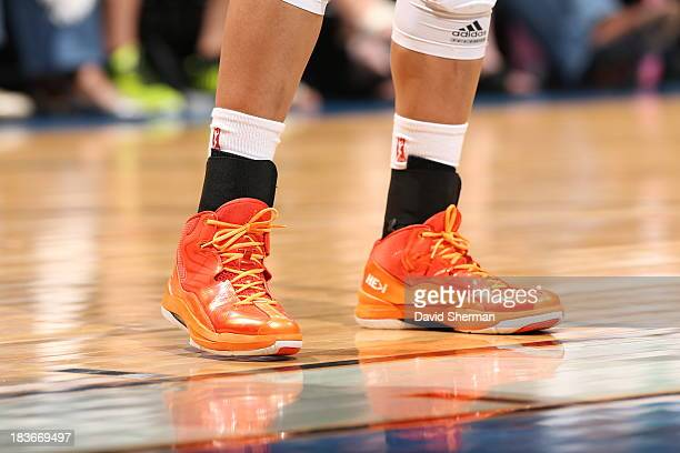 Maya Moore of the Minnesota Lynx stands on the court with her game shoe's during Game 2 of the 2013 WNBA Finals on October 8 2013 at Target Center in...