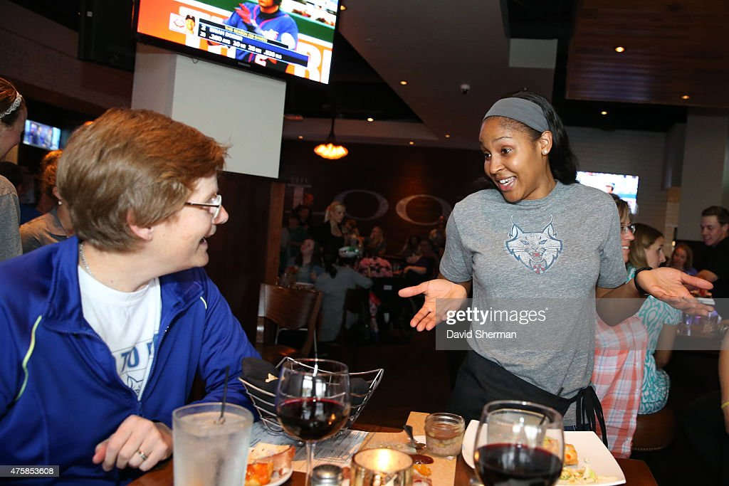 <a gi-track='captionPersonalityLinkClicked' href=/galleries/search?phrase=Maya+Moore&family=editorial&specificpeople=4215914 ng-click='$event.stopPropagation()'>Maya Moore</a> #23 of the Minnesota Lynx talks with fans during the Tip-A-Lynx fundraiser to benefit the Minnesota Lynx Fastbreak Foundation on June 3, 2015 at the Loop West End Bar & Restaurant in Minneapolis, Minnesota.