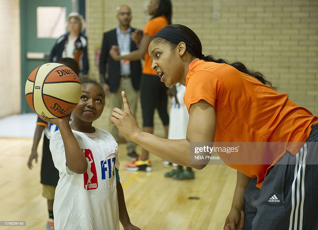 Maya Moore of the Minnesota Lynx works with children during the WNBA Cares Jamba Juice FIT Clinic on July 26, 2013 at Benjamin Dover Jackson Middle School in New London, Connecticut.