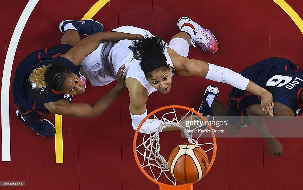 Maya Moore of the USA Basketball Women's National team drives to the basket past Jewell Loyd and Tiffany Mitchell of the USA Basketball Women's...