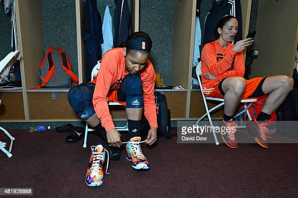 Maya Moore of the Western Conference AllStars ties her sneakers as she prepares for the the Boost Mobile WNBA AllStar 2015 Game at the Mohegan Sun...