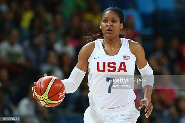 Maya Moore of United States controls the ball during the Women's Quarterfinal match against Japan on Day 11 of the Rio 2016 Olympic Games at Carioca...