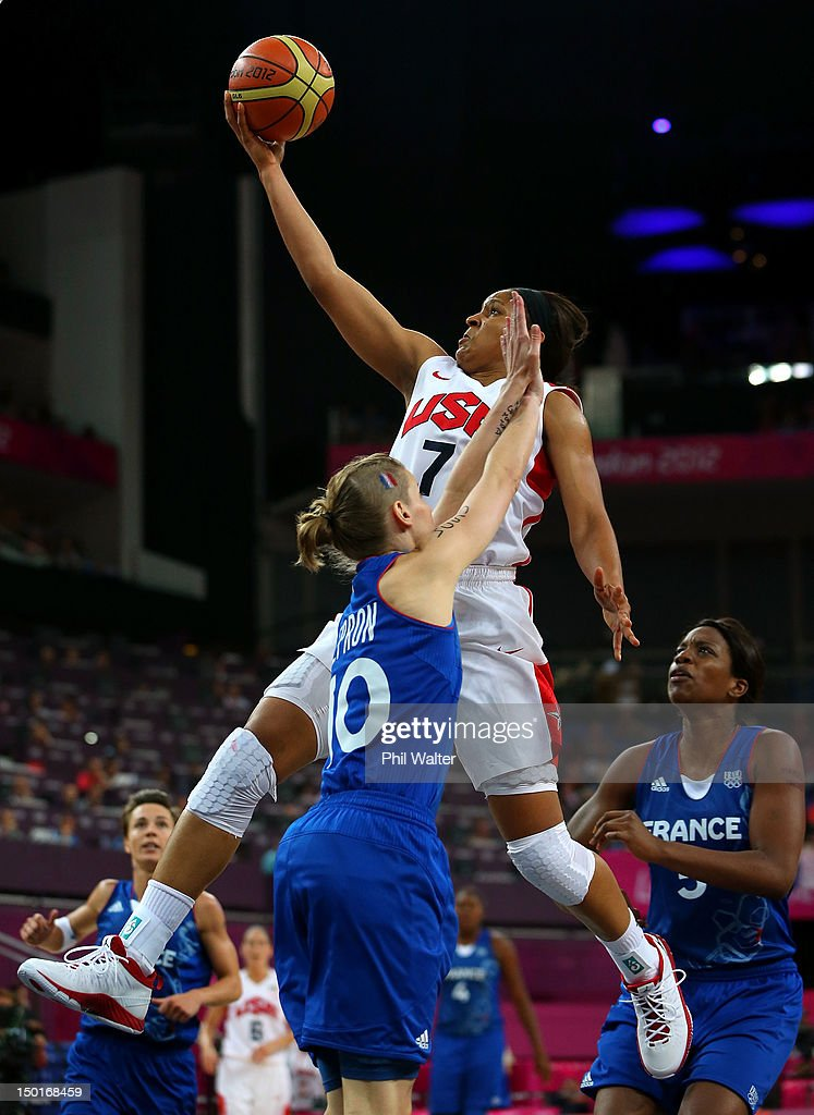 <a gi-track='captionPersonalityLinkClicked' href=/galleries/search?phrase=Maya+Moore&family=editorial&specificpeople=4215914 ng-click='$event.stopPropagation()'>Maya Moore</a> #7 of United States goes up for a shot against Florence Lepron #10 of France in the second half during the Women's Basketball Gold Medal game on Day 15 of the London 2012 Olympic Games at North Greenwich Arena on August 11, 2012 in London, England.