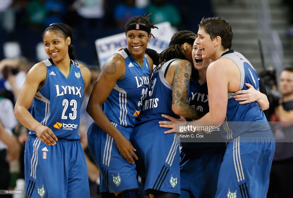 Maya Moore #23, Rebekkah Brunson #32, Seimone Augustus #33, Lindsay Whalen #13, and Janel McCarville #4 of the Minnesota Lynx celebrate in the final seconds of their 86-77 win over the Atlanta Dream during Game Three of the 2013 WNBA Finals at Philips Arena on October 10, 2013 in Atlanta, Georgia.