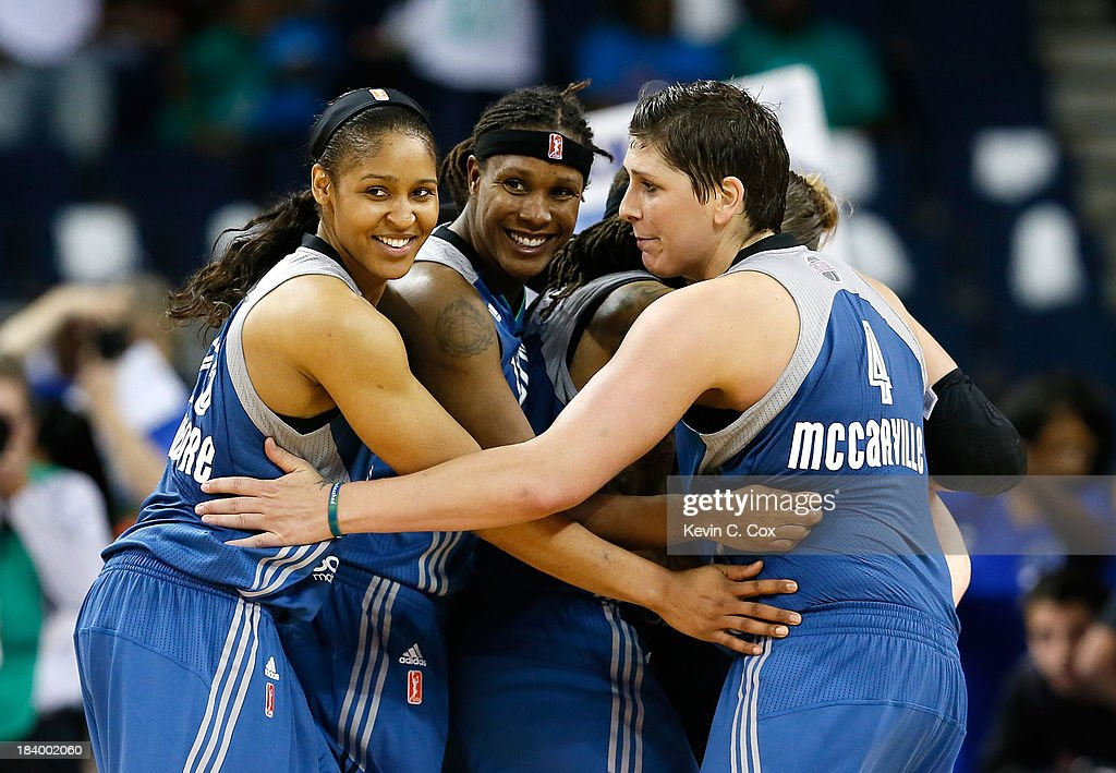 <a gi-track='captionPersonalityLinkClicked' href=/galleries/search?phrase=Maya+Moore+-+Basketball+Player&family=editorial&specificpeople=4215914 ng-click='$event.stopPropagation()'>Maya Moore</a> #23, <a gi-track='captionPersonalityLinkClicked' href=/galleries/search?phrase=Rebekkah+Brunson&family=editorial&specificpeople=213521 ng-click='$event.stopPropagation()'>Rebekkah Brunson</a> #32, <a gi-track='captionPersonalityLinkClicked' href=/galleries/search?phrase=Seimone+Augustus&family=editorial&specificpeople=540457 ng-click='$event.stopPropagation()'>Seimone Augustus</a> #33, <a gi-track='captionPersonalityLinkClicked' href=/galleries/search?phrase=Lindsay+Whalen&family=editorial&specificpeople=208984 ng-click='$event.stopPropagation()'>Lindsay Whalen</a> #13, and <a gi-track='captionPersonalityLinkClicked' href=/galleries/search?phrase=Janel+McCarville&family=editorial&specificpeople=239106 ng-click='$event.stopPropagation()'>Janel McCarville</a> #4 of the Minnesota Lynx celebrate in the final seconds of their 86-77 win over the Atlanta Dream during Game Three of the 2013 WNBA Finals at Philips Arena on October 10, 2013 in Atlanta, Georgia.