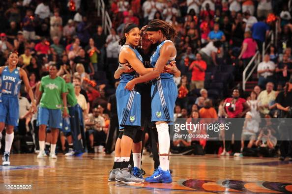 Maya Moore Seimone Augustus and Rebekkah Brunson of the Minnesota Lynx celebrate victory against the Phoenix Mercury in Game Two to win the Western...