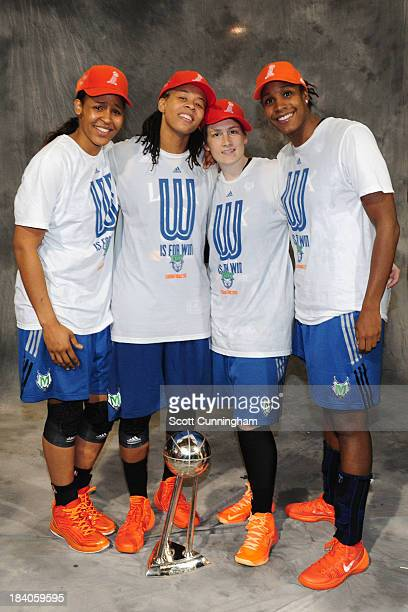 Maya Moore Seimone Augustus Lindsay Whalen and Rebekkah Brunson of the Minnesota Lynx poses for a picture with the trophy after winning Game 3 of the...