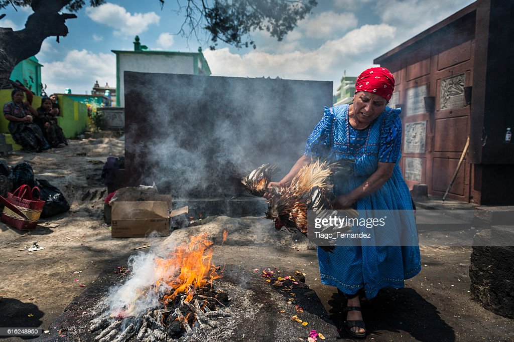 Maya woman performing a ritual in the cemetery of Chichicastenango : Stock Photo