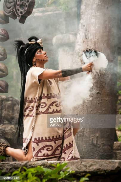 Maya woman performing in Mayan culture show 'Los Rostros de Ek chuah' at Xcaret park Riviera Maya Mexico