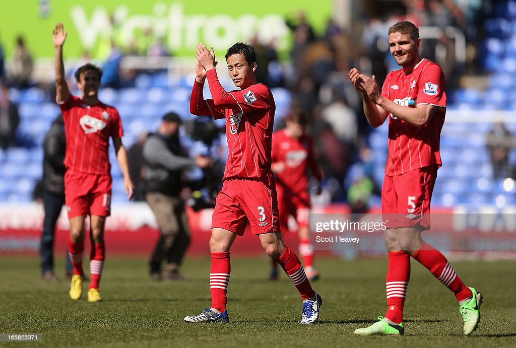 <a gi-track='captionPersonalityLinkClicked' href=/galleries/search?phrase=Maya+Yoshida&family=editorial&specificpeople=5398323 ng-click='$event.stopPropagation()'>Maya Yoshida</a> and Jos Hooiveld of Southampton celebrate victory after the Barclays Premier League match between Reading and Southampton at the Madejski Stadium on April 6, 2013 in Reading, England.