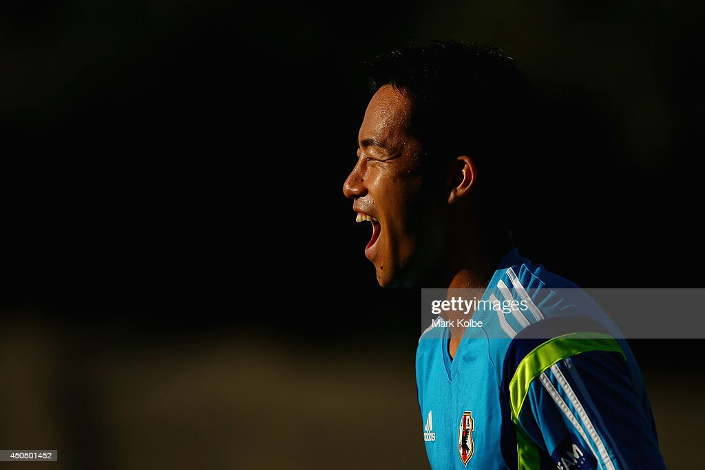 Maya Yoshida laughs during a Japan training session at the Japan national team base camp at the Spa Sport Resort on June 12, 2014 in Itu, Sao Paulo.