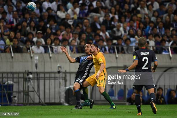 Maya Yoshida of Japan and James Troisi of Australia compete for the ball during the FIFA World Cup Qualifier match between Japan and Australia at...