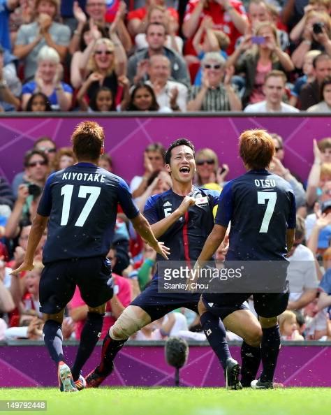 Maya Yoshida of Japan celebrate after scoring with Hiroshi Kiyotake and Yuki Otsu greet him during the Men's Football Quarter Final match between...