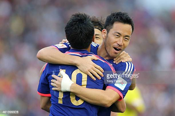 Maya Yoshida of Japan celebrates scoring his team's fourth goal with team mate Shinji Kagawa during the 2015 Asian Cup match between Japan and...