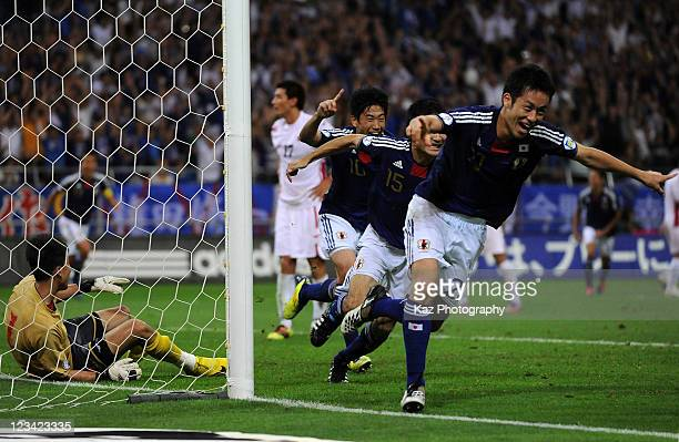 Maya Yoshida of Japan celebrates the first goal during the 2014 FIFA World Cup Brazil Asian 3rd Qualifier match between Japan and North Korea at...
