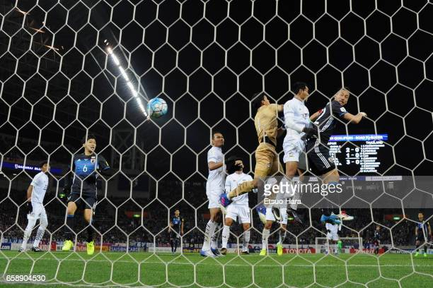 Maya Yoshida of Japan heads the ball to score his side's fourth goal during the 2018 FIFA World Cup Qualifier match between Japan and Thailand at...