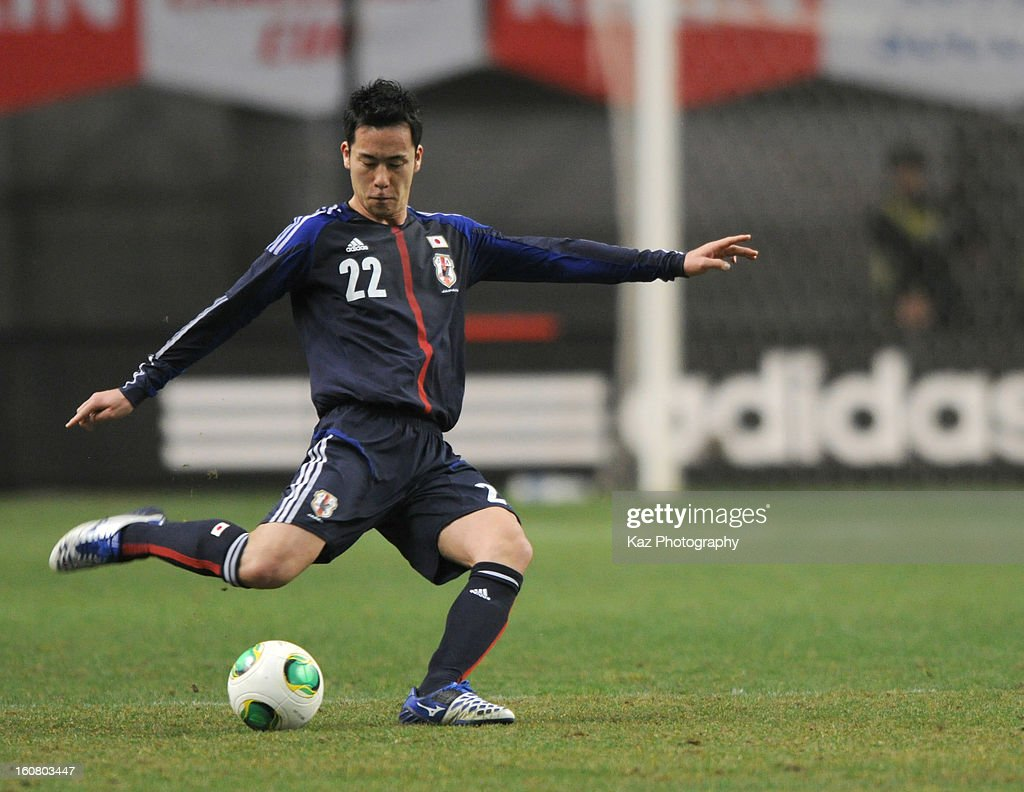 <a gi-track='captionPersonalityLinkClicked' href=/galleries/search?phrase=Maya+Yoshida&family=editorial&specificpeople=5398323 ng-click='$event.stopPropagation()'>Maya Yoshida</a> of Japan passes the ball during the international friendly match between Japan and Latvia at Home's Stadium Kobe on February 6, 2013 in Kobe, Japan.