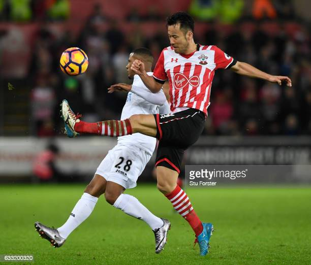 Maya Yoshida of Southampton and Luciano Narsingh of Swansea City compete for the ball during the Premier League match between Swansea City and...