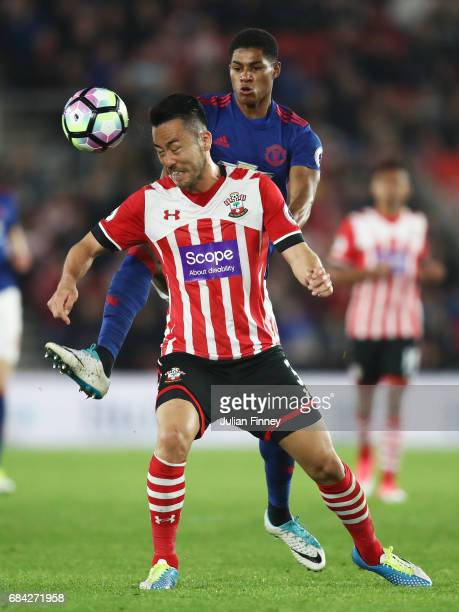 Maya Yoshida of Southampton and Marcus Rashford of Manchester United battle for possession during the Premier League match between Southampton and...