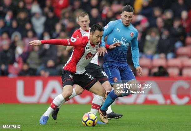Maya Yoshida of Southampton and Sead Kolasinac of Arsenal during the Premier League match between Southampton and Arsenal at St Mary's Stadium on...