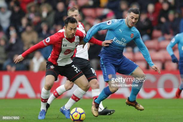 Maya Yoshida of Southampton and Sead Kolasinac of Arsenal in action during the Premier League match between Southampton and Arsenal at St Mary's...