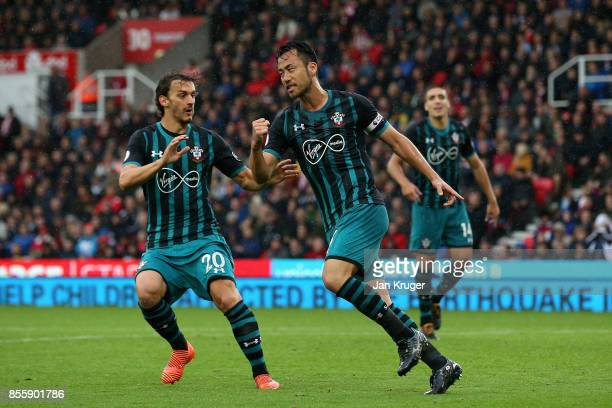 Maya Yoshida of Southampton celebrates scoring his side's first goal with his team mate Manolo Gabbiadini during the Premier League match between...
